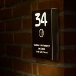 Toleding: Deurbel, huisnummer, naambordje èn licht